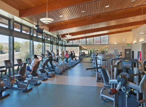 View of the fitness center showing recumbant bikes, elipitcals and treadmills.